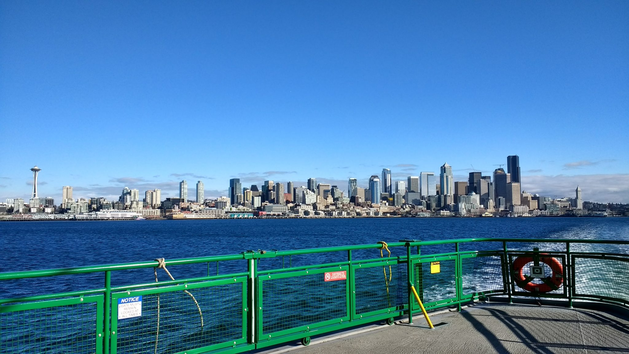 The Seattle city skyline from the ferry. The deck of the ferry is in the foreground. The ferry is a popular day trip from Seattle