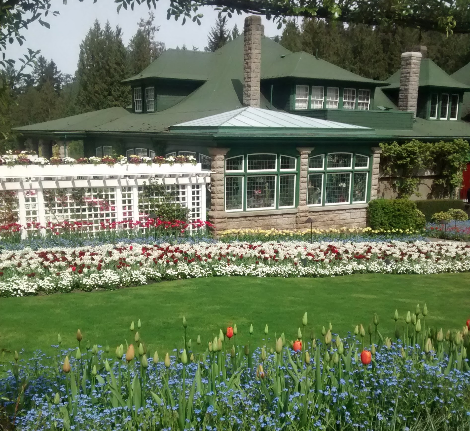 A historic home surrounded by formal gardens at Butchart Gardens in Victoria, a popular day trip from Seattle