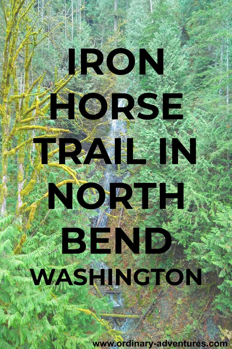 Green forest surrounds a narrow, high waterfall. Text reads Iron Horse Trail in North Bend