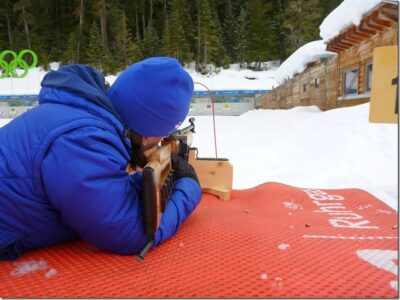 A person holds a gun designed for use in the Olympic Sport of Biathlon on the Biathlon range to learn a new Olympic sport, one of many on offer at Whistler Olympic park