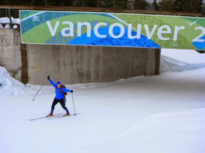 "A person skis under a sign that says ""Vancouver"" leftover from the Winter Olympics in 2010. Cross country skiing is one winter sport you can learn at Whistler Olympic Park."
