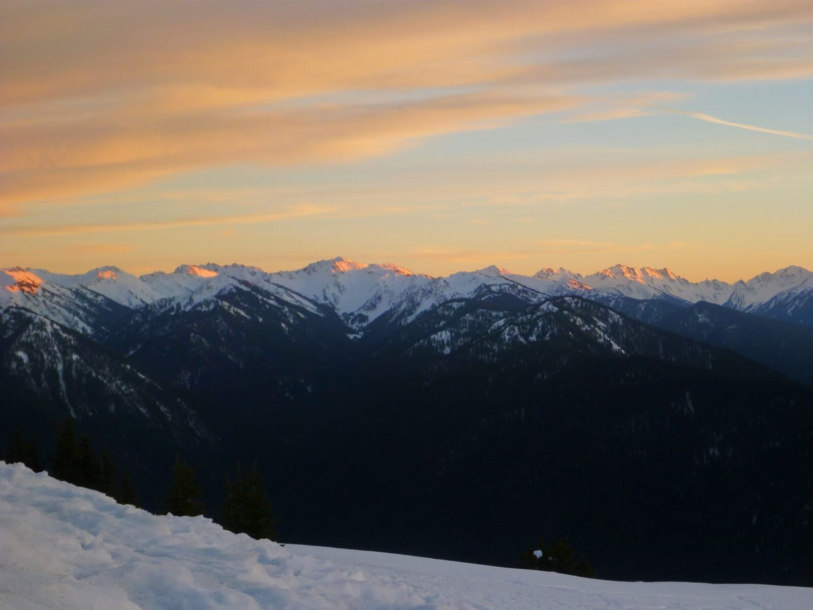 Last bit of pink sunset lingers on the mountains of from Hurricane Ridge, a favorite day trip from Seattle