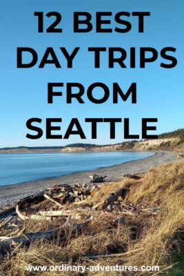 The beach on Whidbey Island on a sunny day. Text reads 12 best day trips from Seattle
