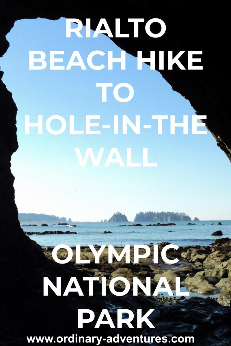 A large hole in a rock on the beach in Olympic National Park. Tidepools are under the arch and distant islands can be seen in the ocean in the distance. Text reads: Rialto beach hike to Hole-in-the-wall Olympic National Park