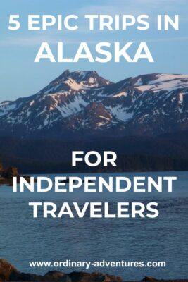 Snowy mountains at sunset above the water. Text reads 5 epic trips in Alaska for independent travelers