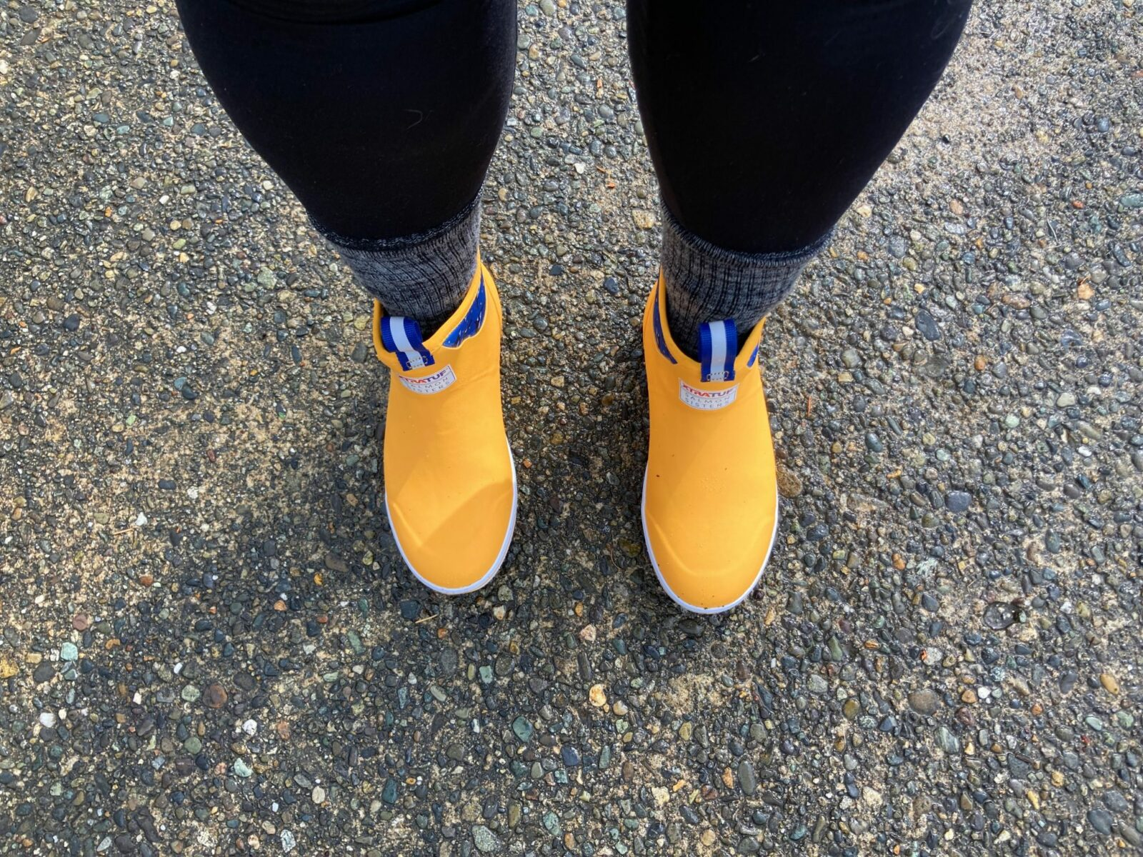 An important consideration in what to pack for seattle is waterproof footwear. These bright yellow waterproof ankle boots are my favorite!