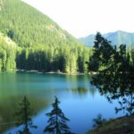 Lena Lake, an alpine lake on a sunny day surrounded by forested hillsides