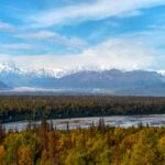 Epic landscapes on the drive to Alaska include high distant snow capped mountains, river valleys and forests